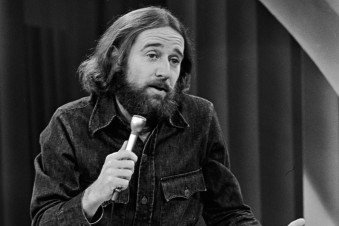 George Carlin Performing On Stage