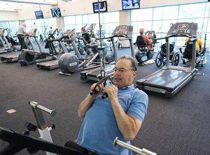Man-Exercising-in-Fitness-Center-300x222