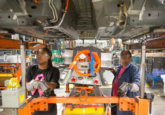 Detroit resident Evetta Osborne, (right), works side by side with her daughter, Monique Watson, at General Motors' Detroit-Hamtramck assembly plant where the two have installed the lithium-ion battery pack on nearly every Chevrolet Volt, Opel Ampera, Holden Volt, and Cadillac ELR since production began.