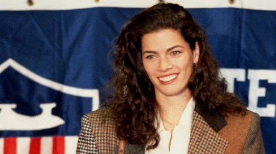 Figure skater Nancy Kerrigan smiles as she takes h
